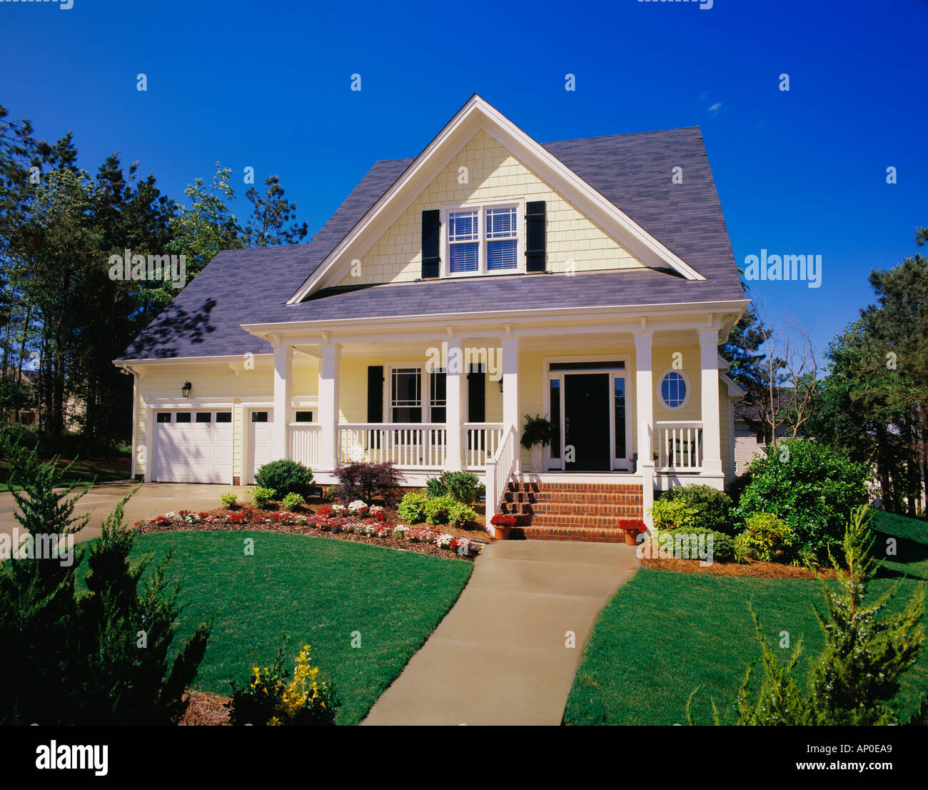 Front Porch Of Yellow House Stock Photo: Small Two Story Yellow House With Black Shutters A Large