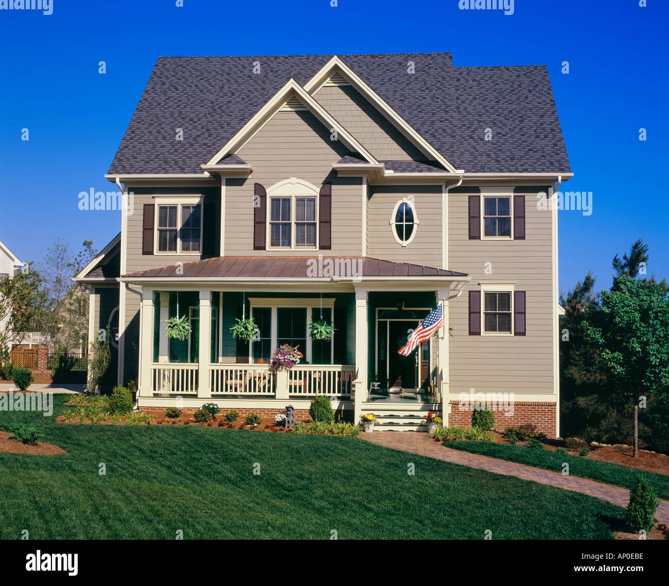 Front view of a large brown two story house with white for See images of my house