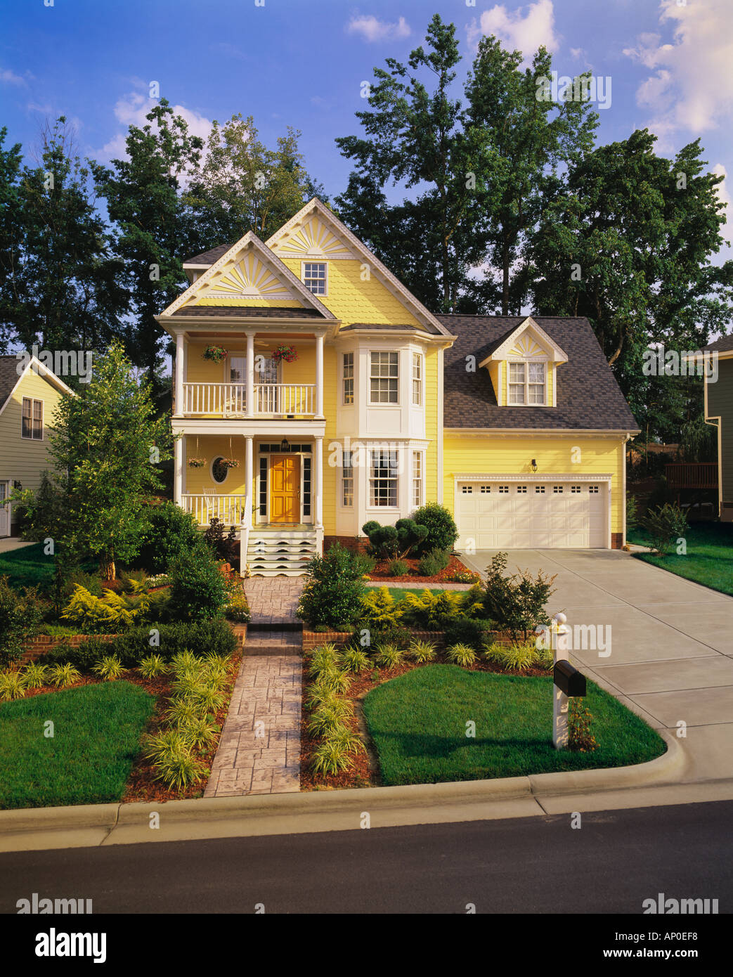 Front view of a large two story yellow house with white - White house white trim ...