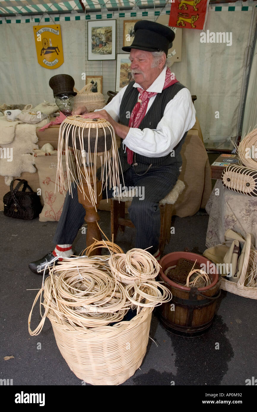 Frenchman in national costume weaving baskets at Cider Fayre Caudebec en Caux on River Seine near Lillebonne France - Stock Image