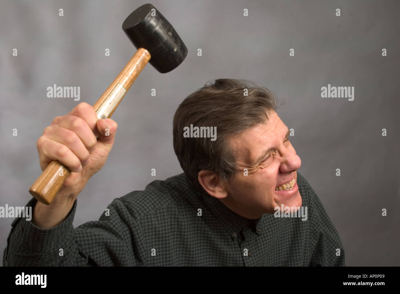 Man about to hit himself on the head with a hard rubber mallet Model  Released Stock Photo - Alamy