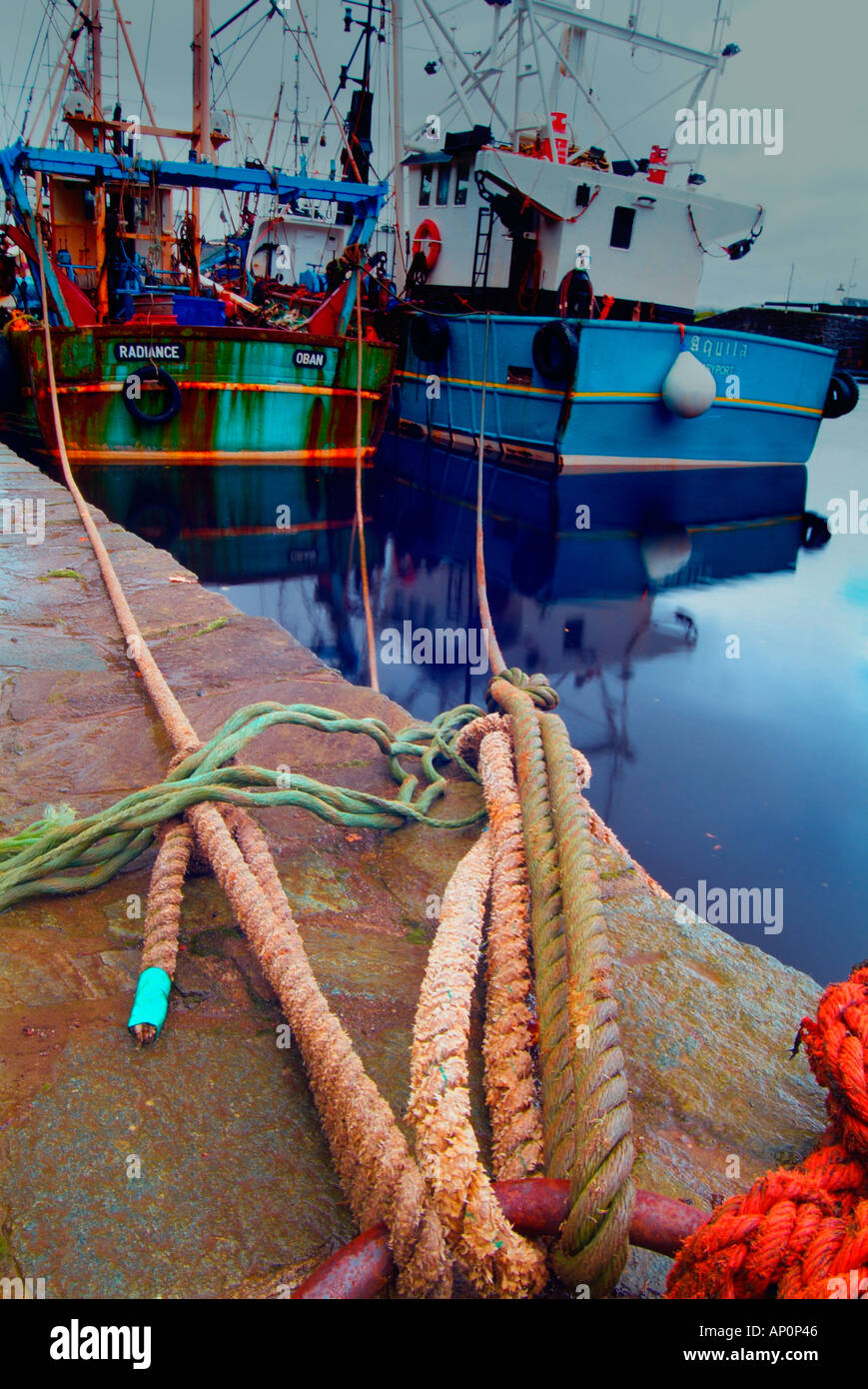 Fishing boat tied up at crinan harbour Argyll Scotland - Stock Image