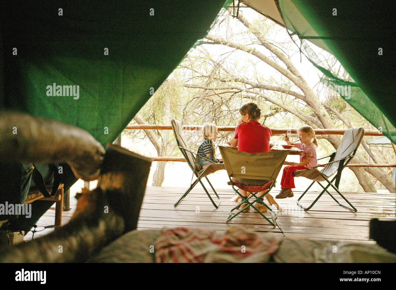 Family eating on campside, bush camp, Eastern Cape, South Africa - Stock Image