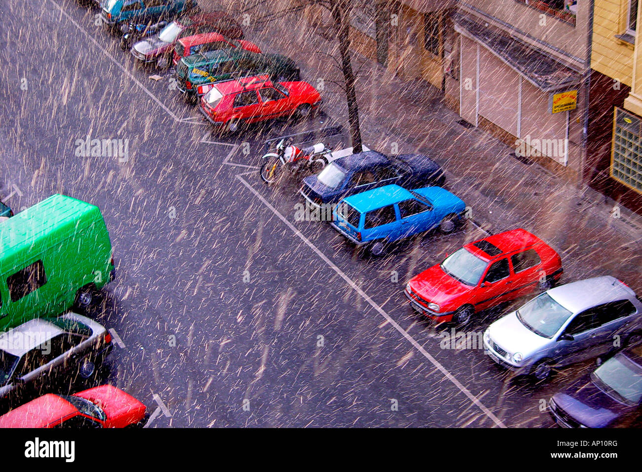 Snowfall in Berlin with parked cars, Neukoelln, Berlin, Germany - Stock Image