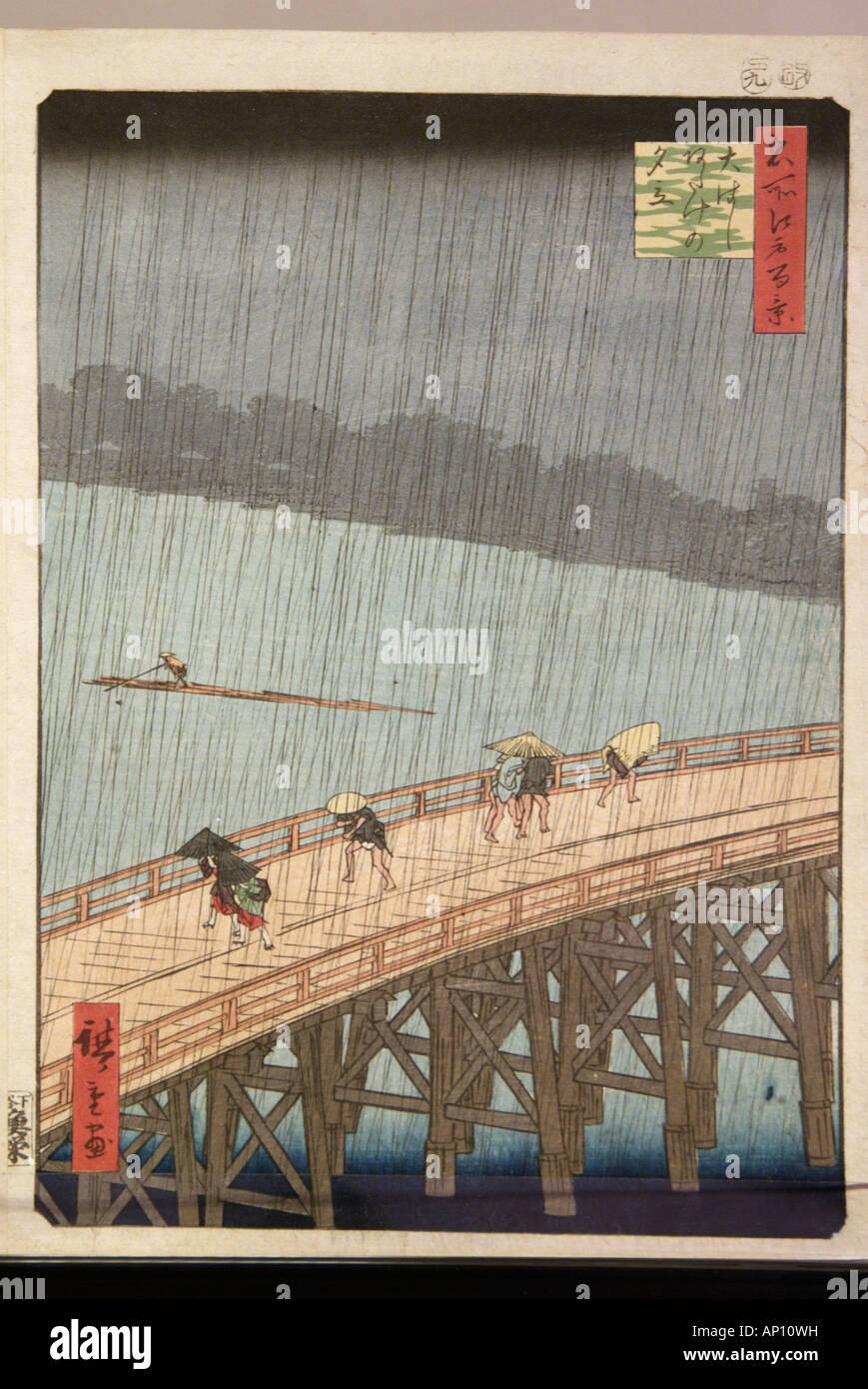 Japanese Ukiyo e print Japan Japanese crossing bamboo wood wooden bridge rain downpour shower wet deluge river cross - Stock Image