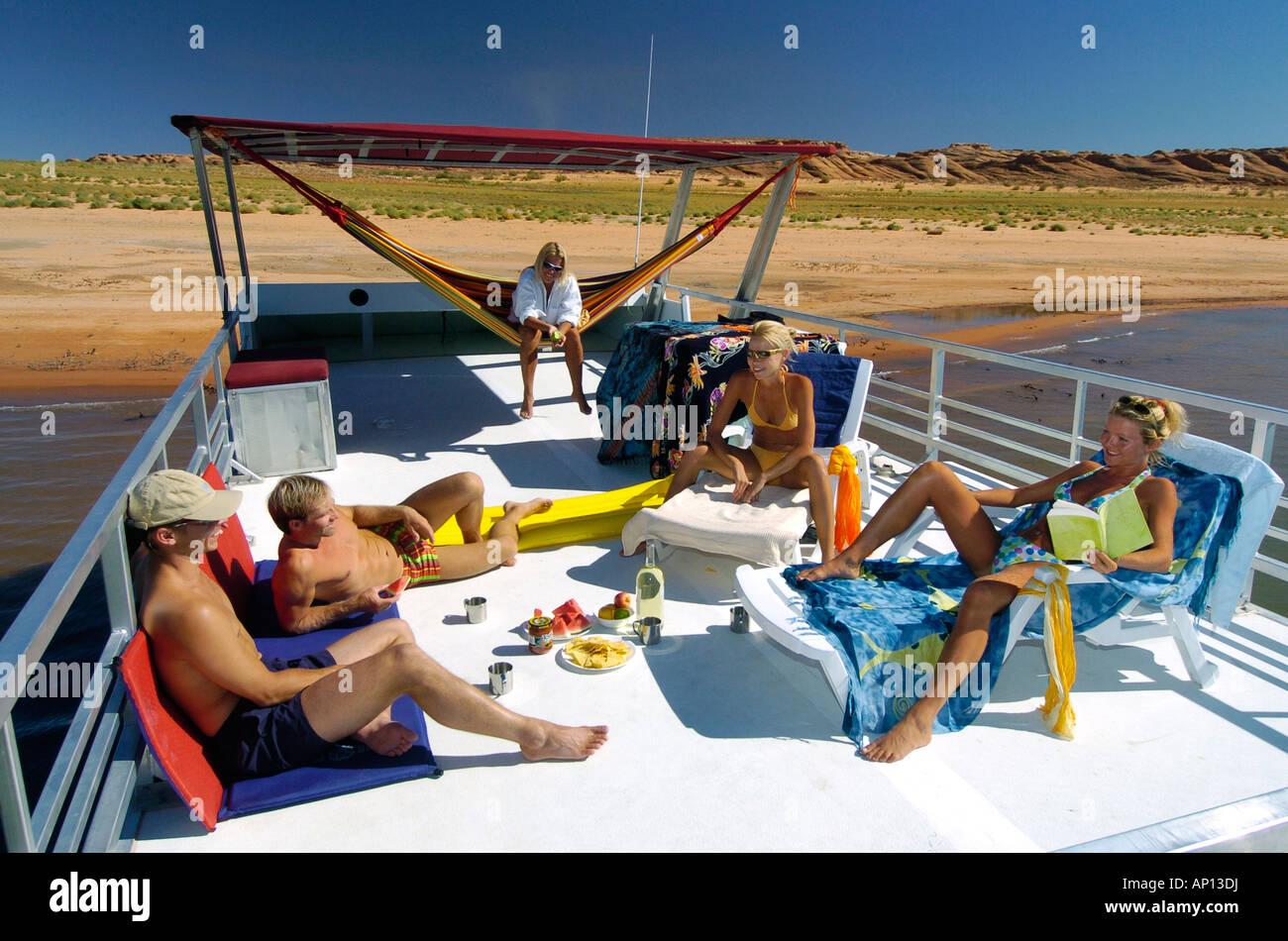 People On Houseboat Lake Powell Arizona Utah Usa Stock Photo
