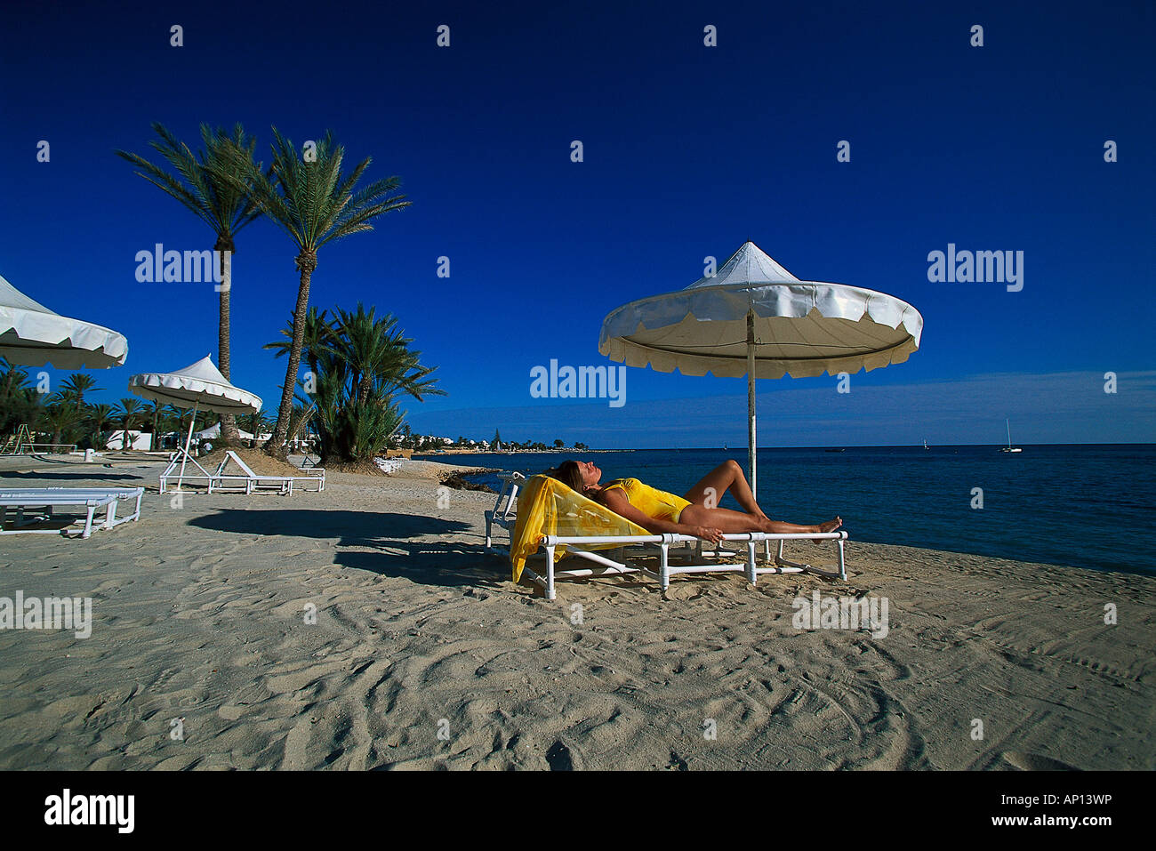 Woman on beach, La Douce, Djerba, Tunesia - Stock Image
