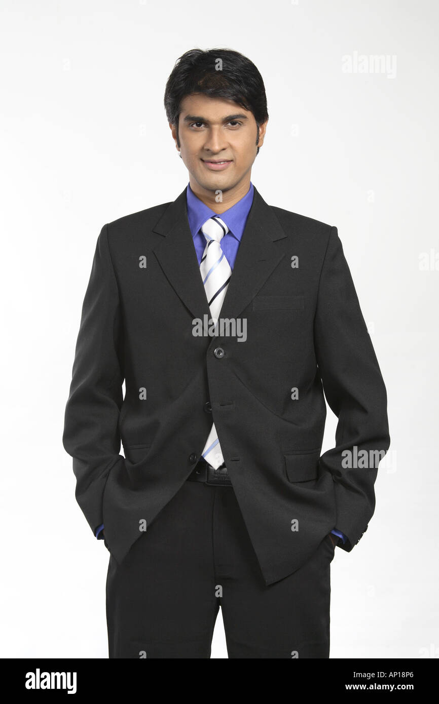 Ang200025 Executive Hands In Pockets Smiling Wearing Black Suit Blue