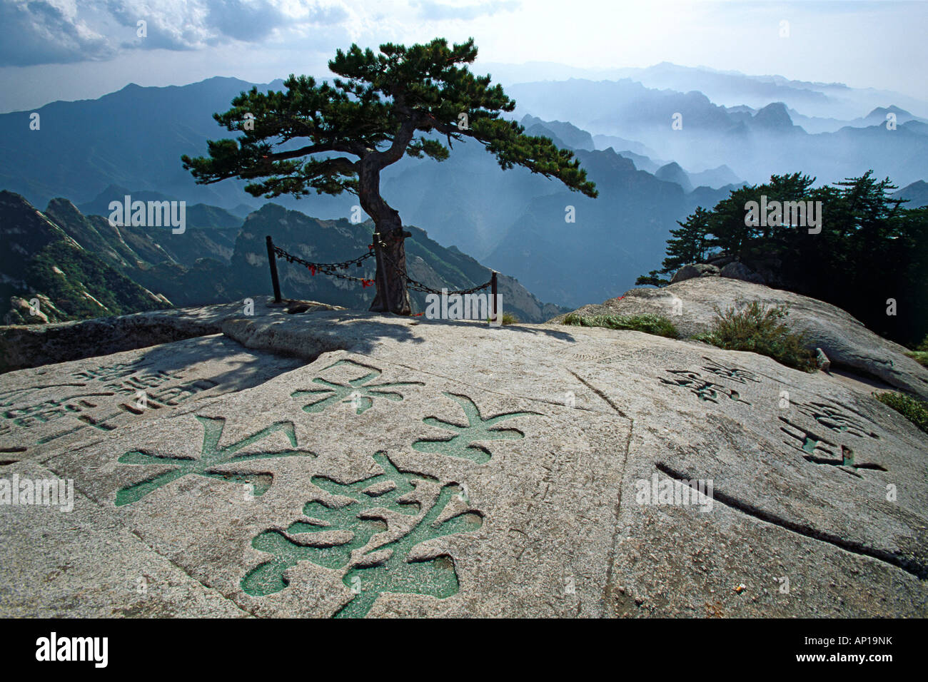 Chinese characters engraved in stone, South Peak, Hua Shan, Shaanxi province, Taoist mountain, China, Asia - Stock Image