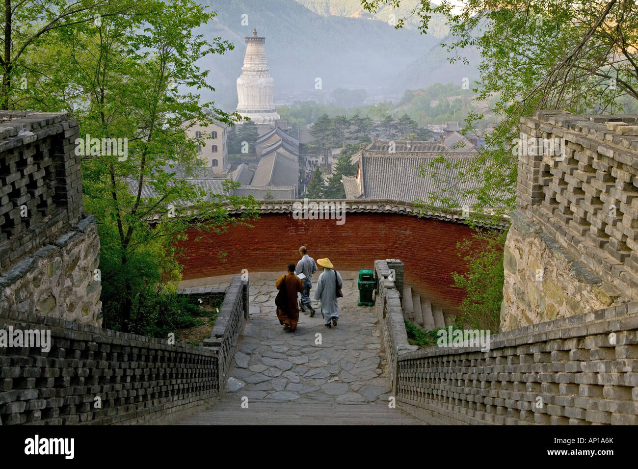 Stairs to Pusa Ding temple, White Pagoda, Xiantong Temple in the background, during birthday celebrations for Wenshu, - Stock Image
