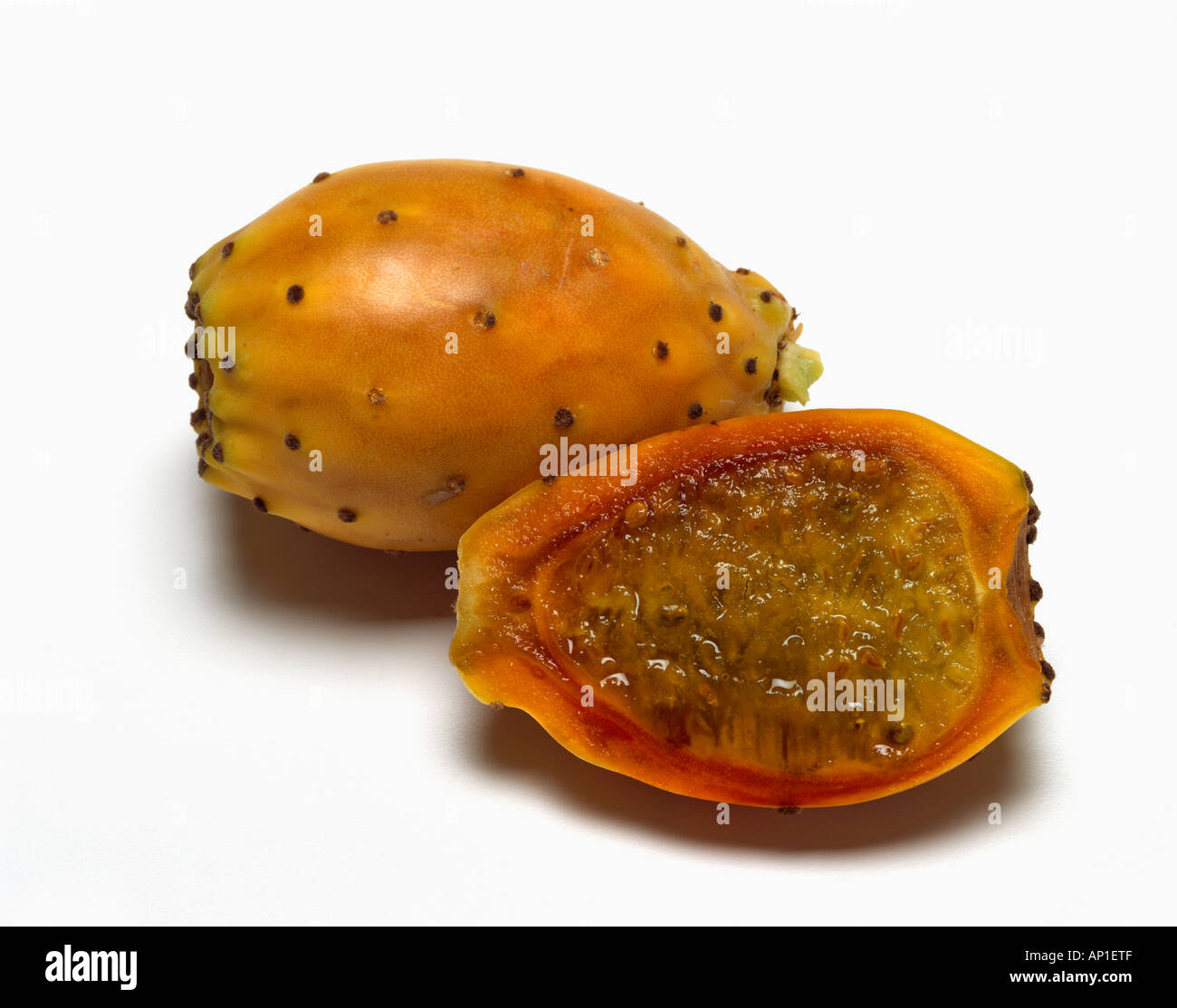 Agriculture - Ripe yellow cactus pears with one sliced open of the Opuntia genus / California, USA. - Stock Image