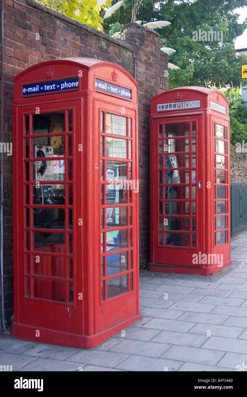 Updated telephone box next to a traditional one, Queen Street, Exeter, Devon - Stock Image