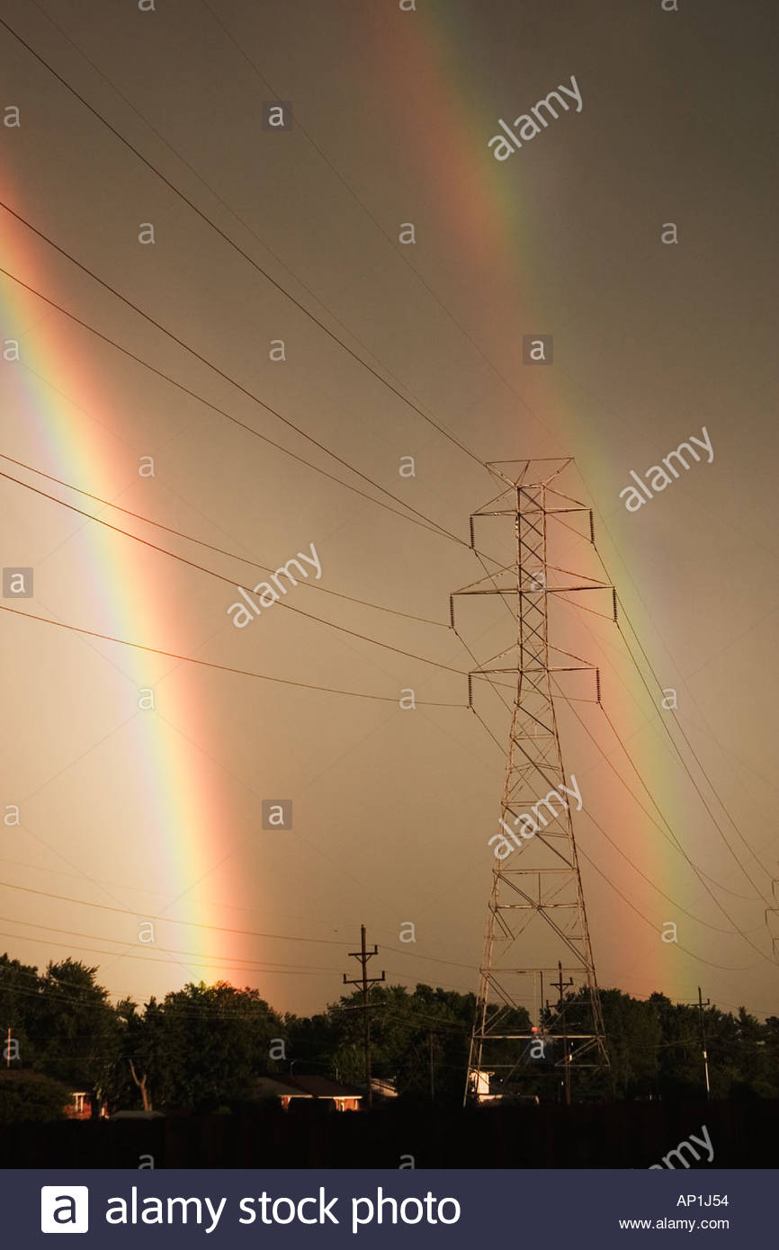Double rain bow during storm and power lines  - Stock Image