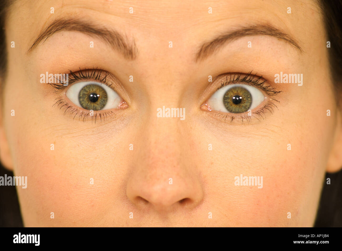 https://c8.alamy.com/comp/AP1JB4/woman-with-eyes-wide-open-in-surprise-or-shock-AP1JB4.jpg