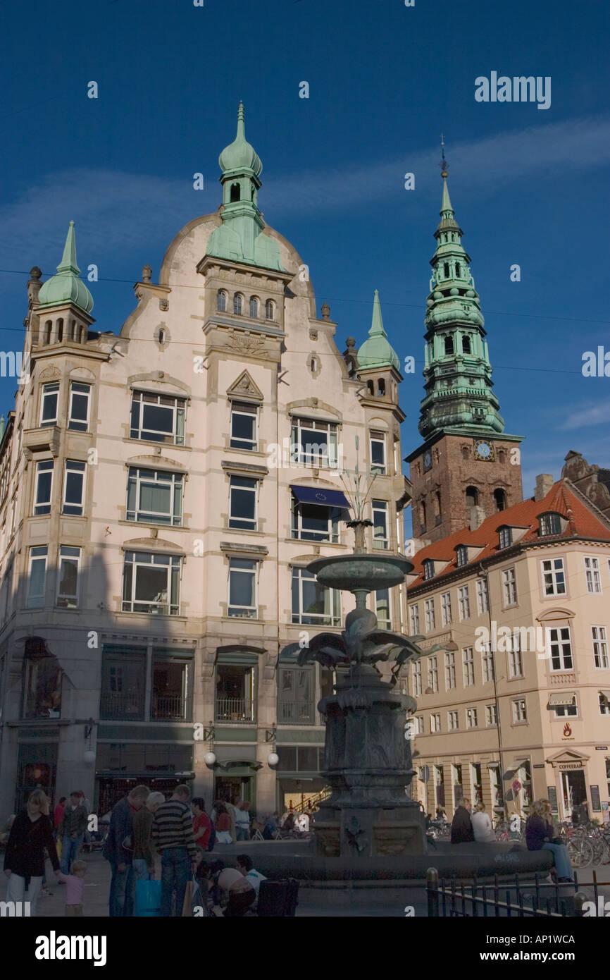 Amagertorv, showing Stork Fountain, cafes, and Nicolai Kirke tower, Stroget, Copenhagen, Denmark - Stock Image
