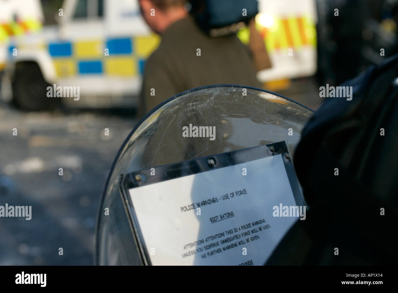 PSNI baton round warning on shield during riot on crumlin road at ardoyne shops belfast 12th July - Stock Image
