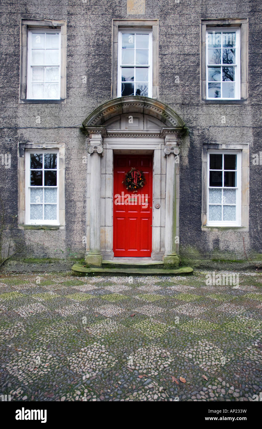 Georgian House With Red Front Door And Christmas Wreath Stock Photo