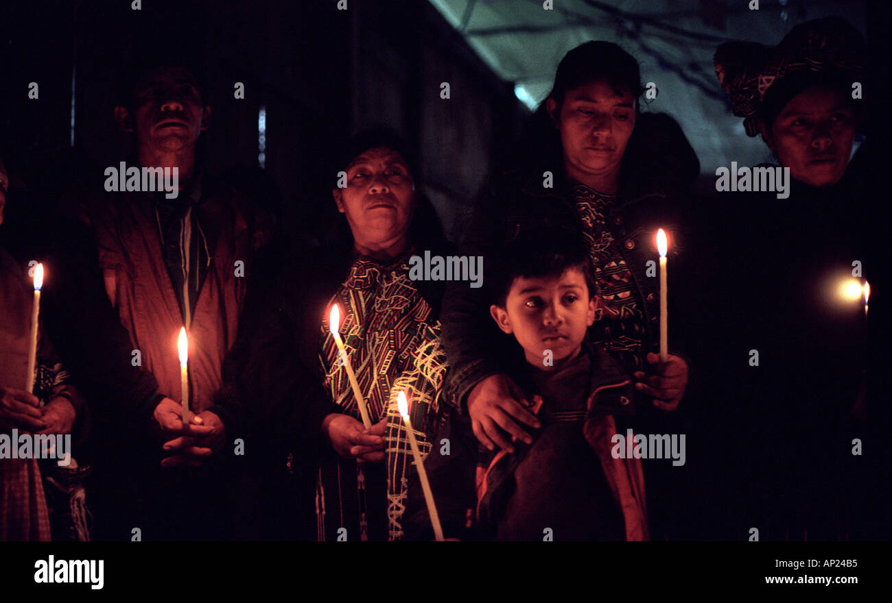 Vigil over coffins of relatives massacred by Guatemala soldiers in Pulay Ixil Triangle Guatemala - Stock Image