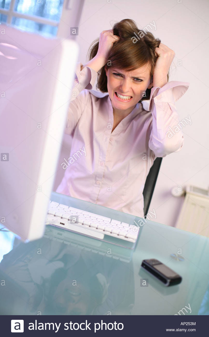 woman works with pc - Stock Image