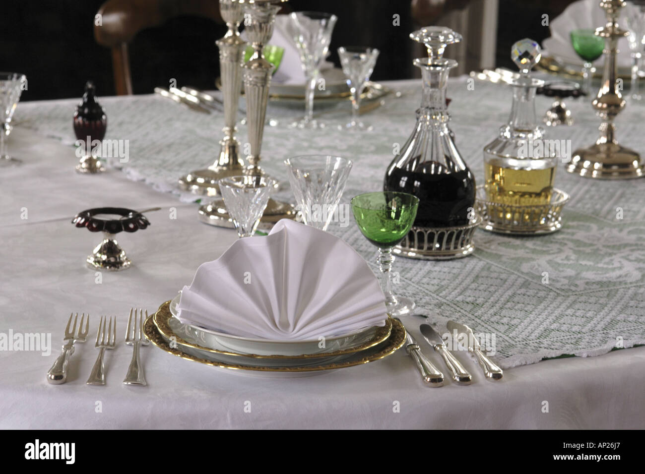 Victorian style table setting for dinner in a manor house with folded serviette & Victorian style table setting for dinner in a manor house with ...