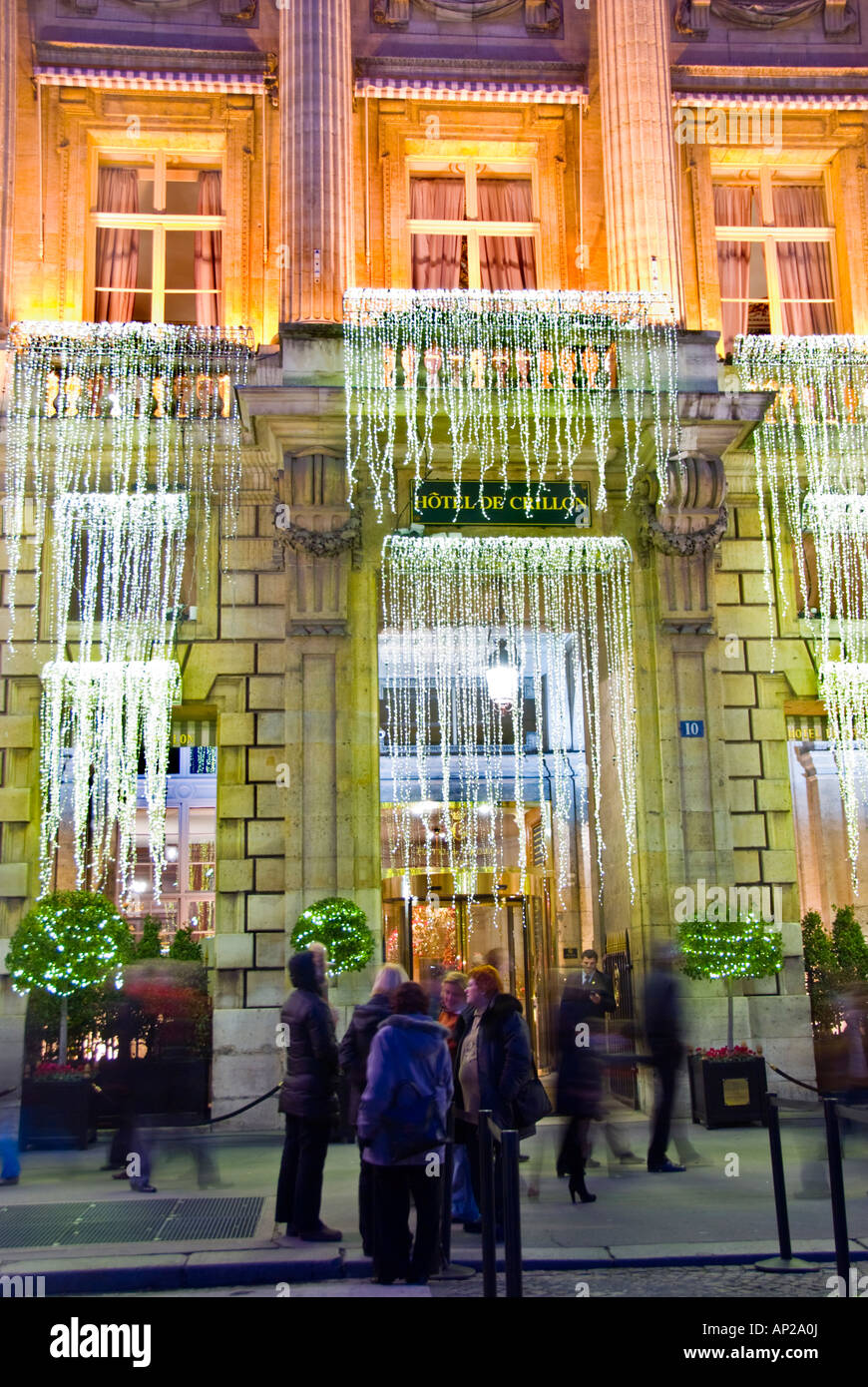paris france people enjoying lights deluxe hotel hotel de crillon lit up with christmas decorations at night front entrance