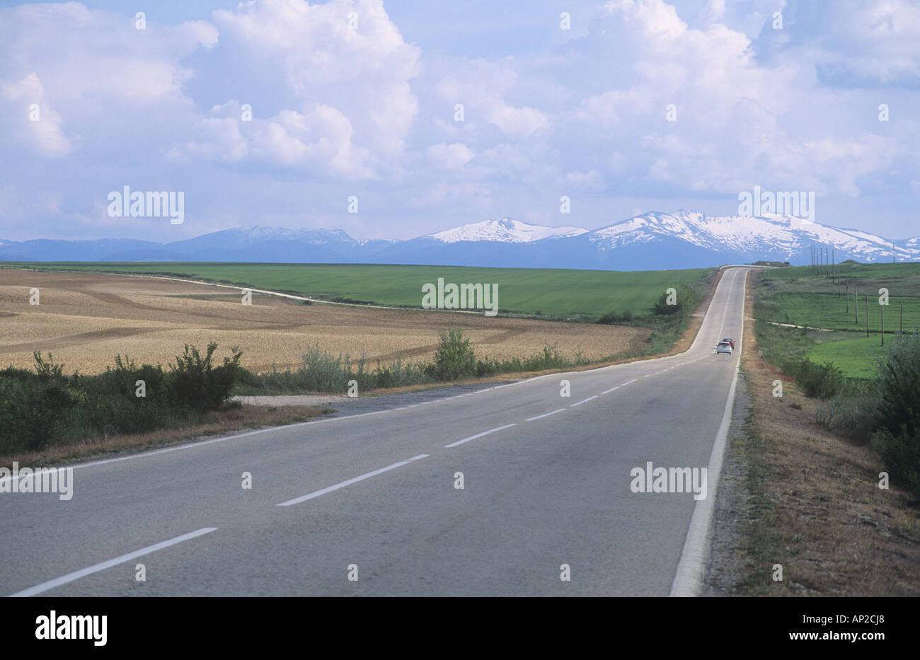 Road between Turegano and Segovia, with Sierra de Guadarrama in background, Castilla-Leon, Spain Stock Photo