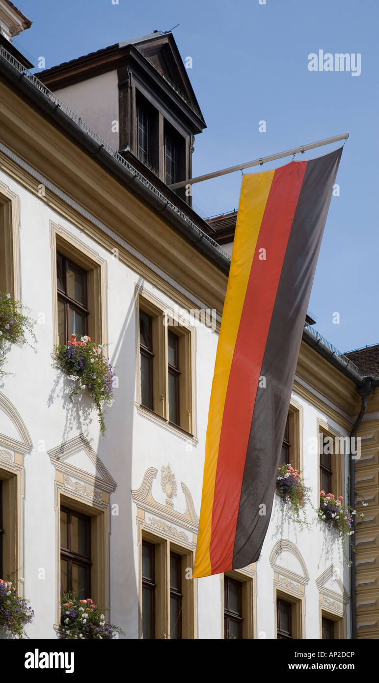 German flag flying outside town hall, Regensburg, Germany - Stock Image