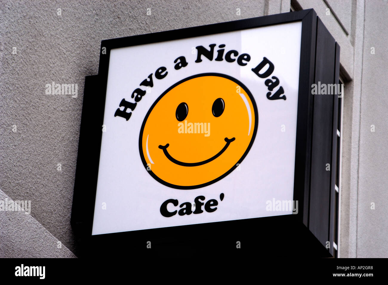 Sign on building Have a Nice Day Cafe Stock Photo