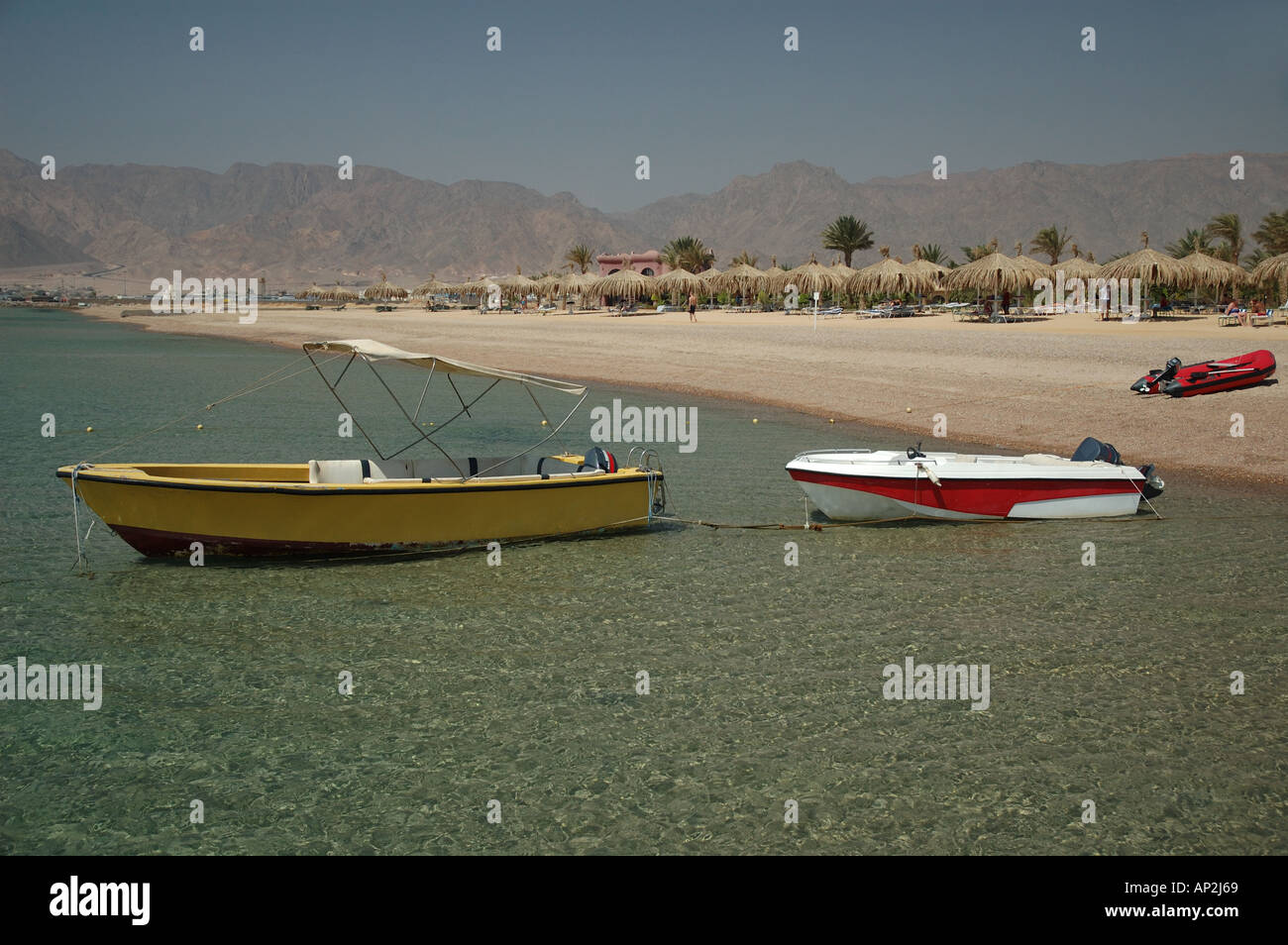 Three small powerboats used for water sports activities moored at the Coral Hilton Resort beach in Nuweiba Egypt - Stock Image