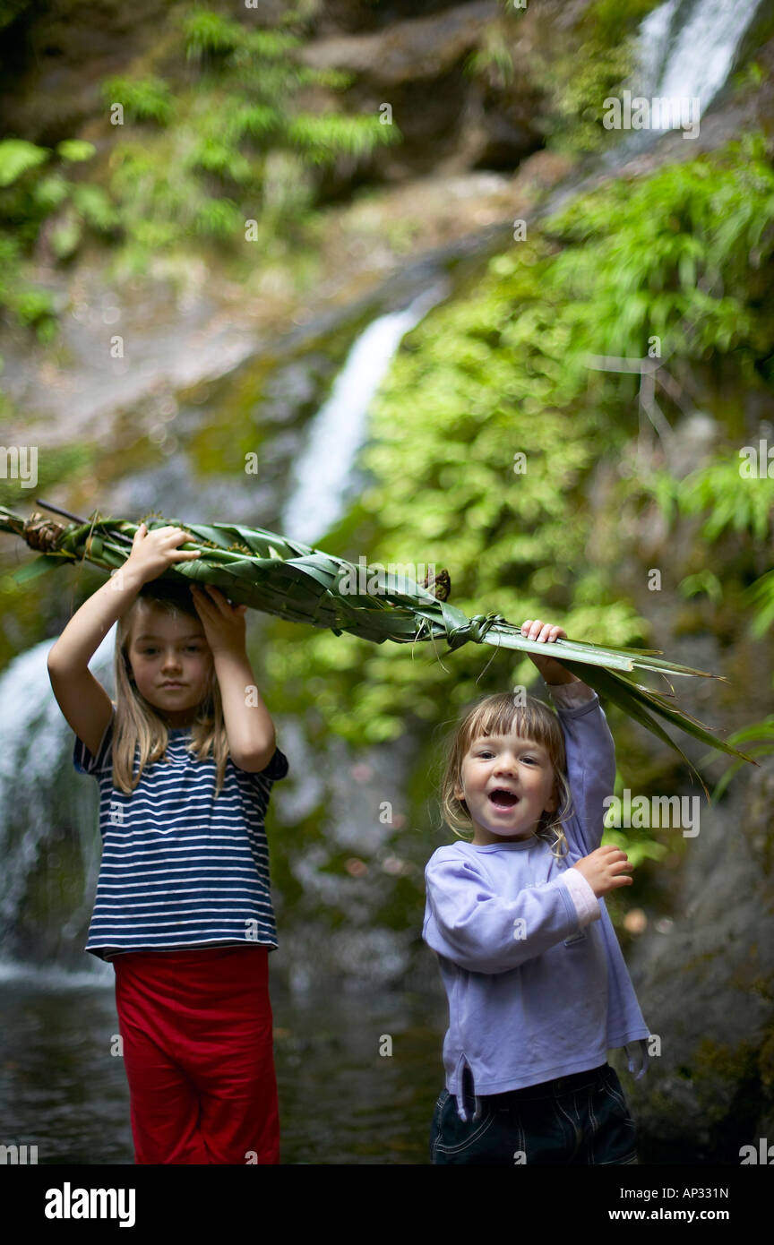 New Years Day: self-made boat (New Zealand flachs) will carry our wishes for the year, cascades, waterfall near - Stock Image