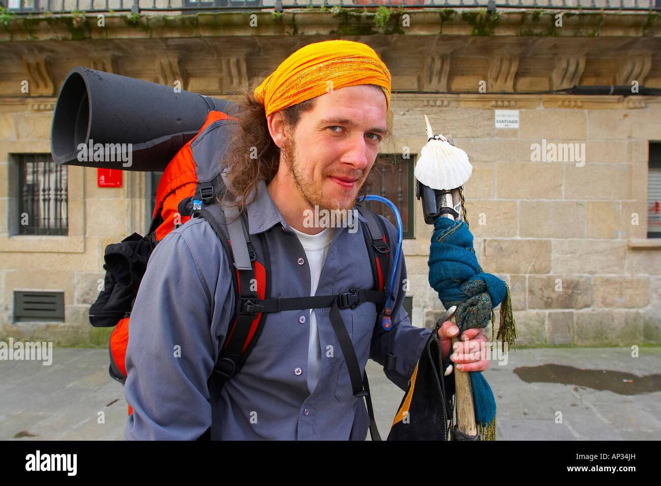 A man, pilgrim finally at his destination, St. James Way, Praza de Cervantes, Santiago de Compostela, Galicia, Spain - Stock Image