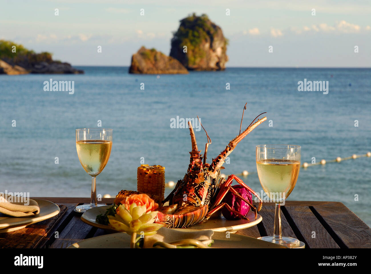 Spiny Lobster dish at Beach Restaurant The Grotto with sea view Stock Photo: 15660770 - Alamy