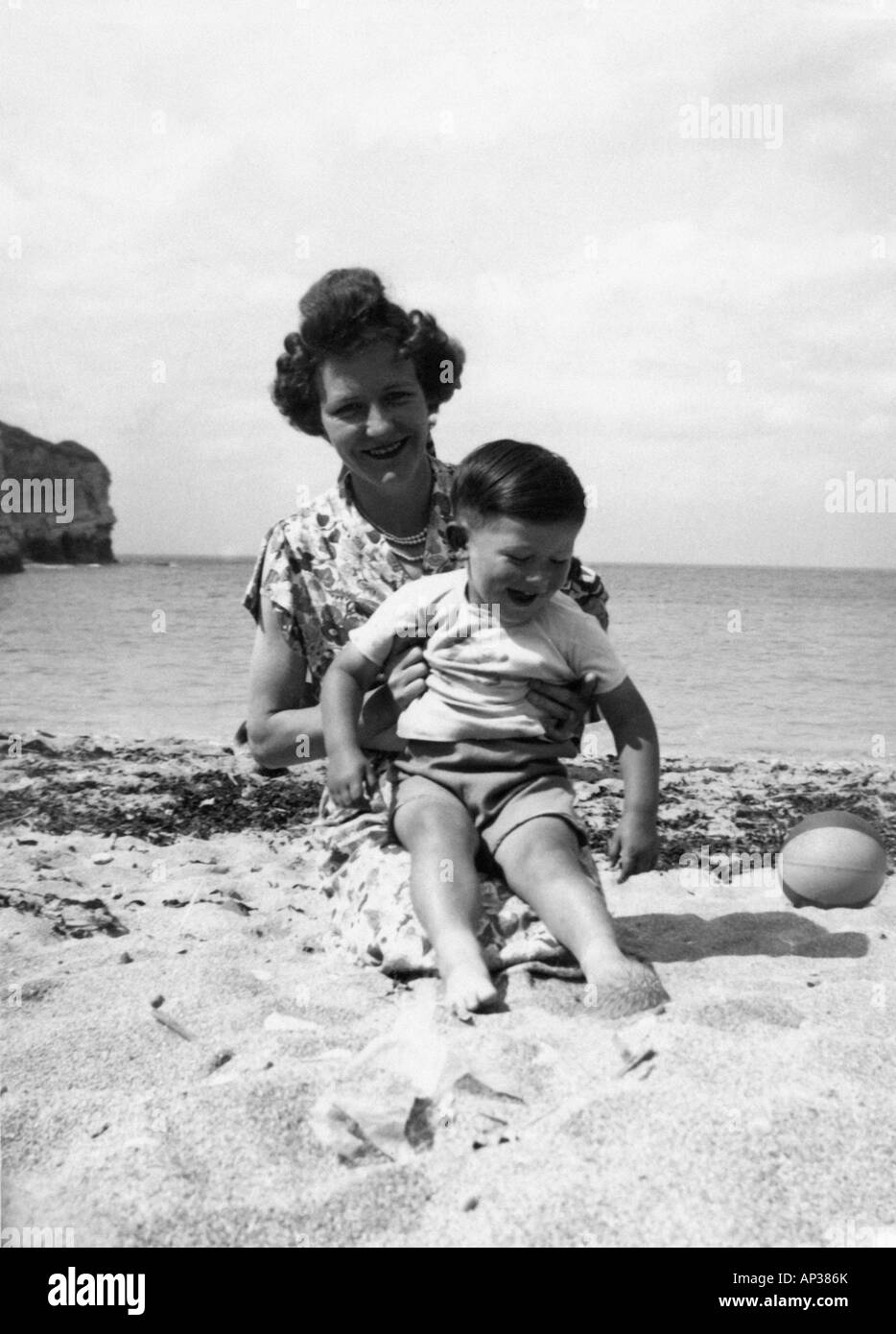 Old Black And White Family Portrait Snap Shot Of Mother And Son