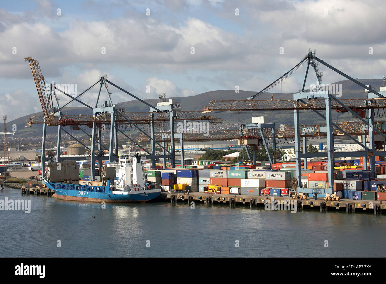Containers being loaded onto the Coastal Deniz ship in Port of Belfast - Stock Image