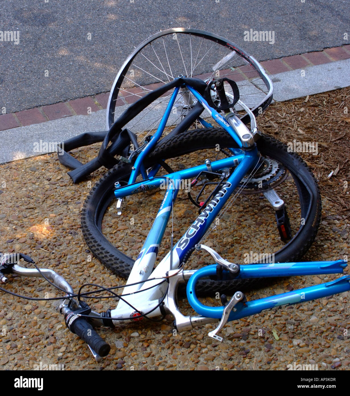 A Mangled Blue Bicycle Lies Wrecked on a Sidewalk in Washington DC United States America USA - Stock Image