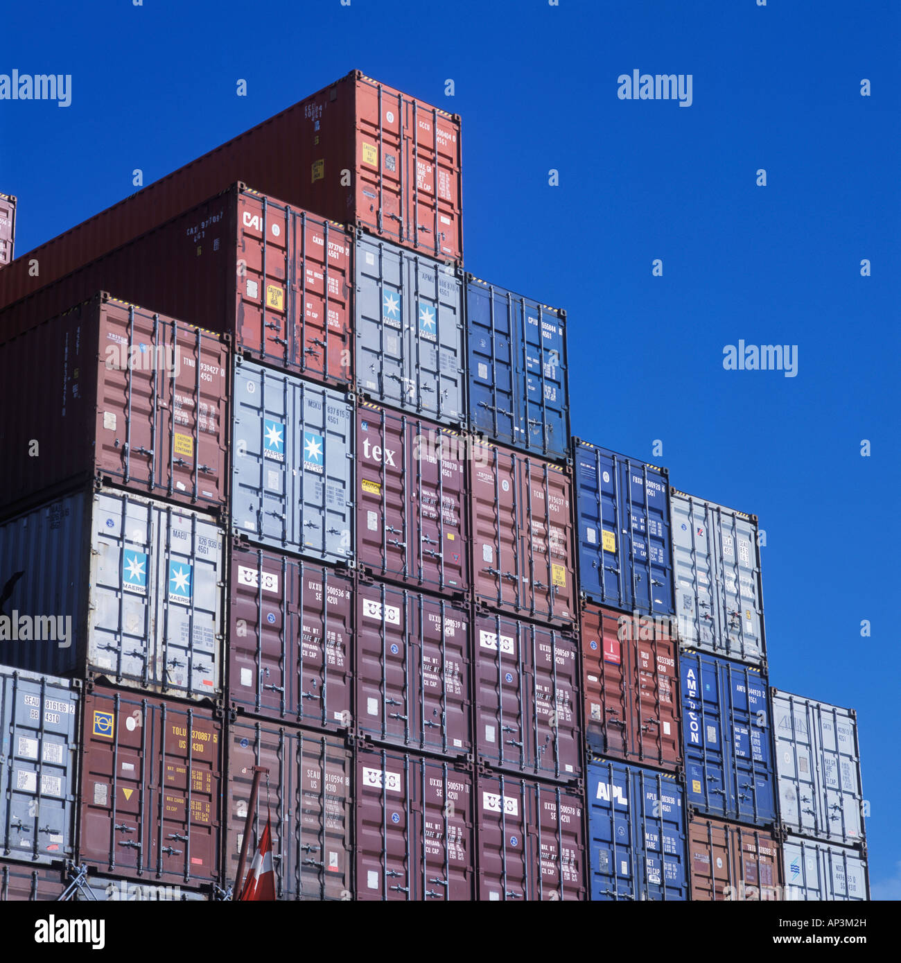 Shipping containers stacked and ready for transportation - Stock Image