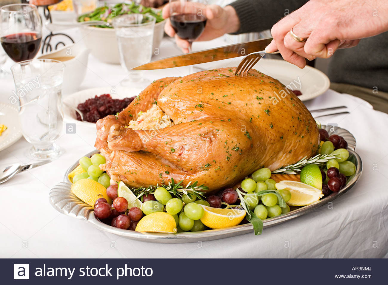 Person carving turkey - Stock Image