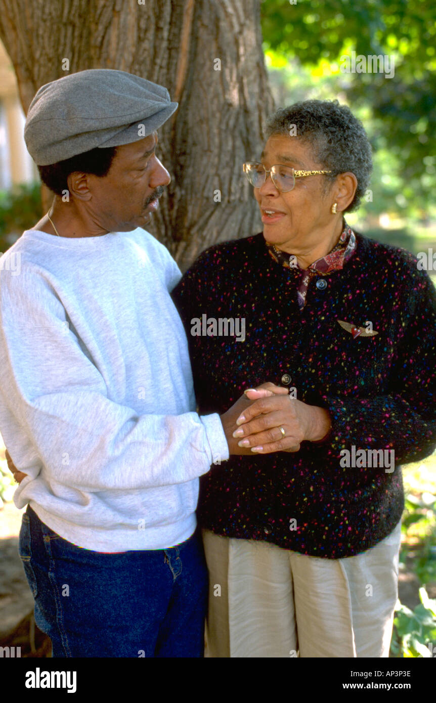 A friendly conversation between friends age 70 in the park. St Paul Minnesota MN USA - Stock Image
