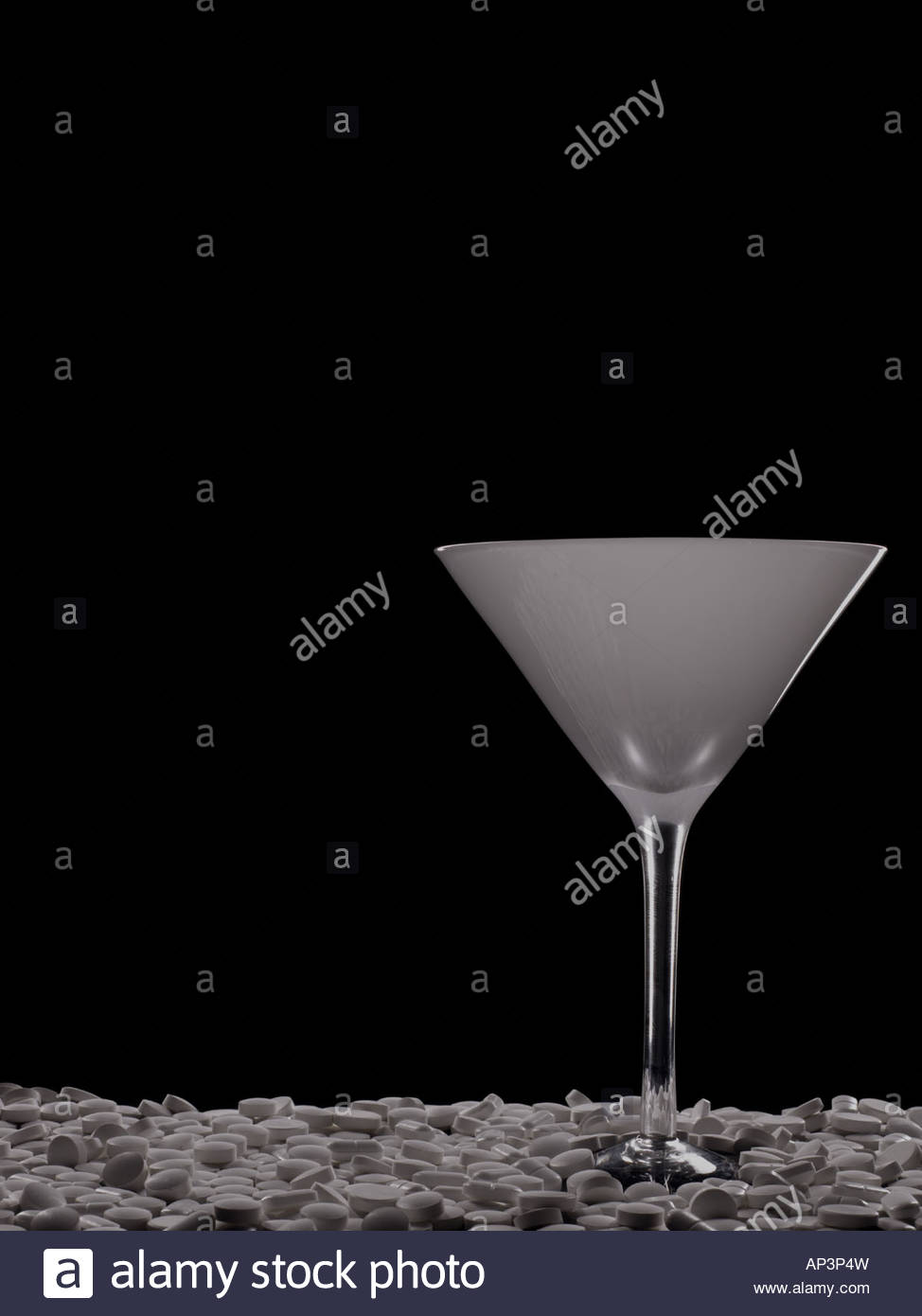 Cocktail glass and tablets - Stock Image