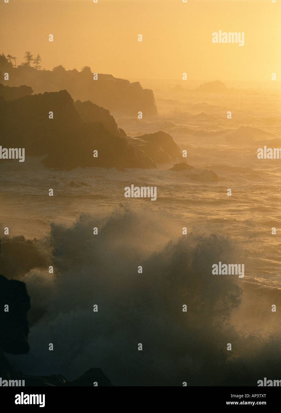 Waves against rocks - Stock Image