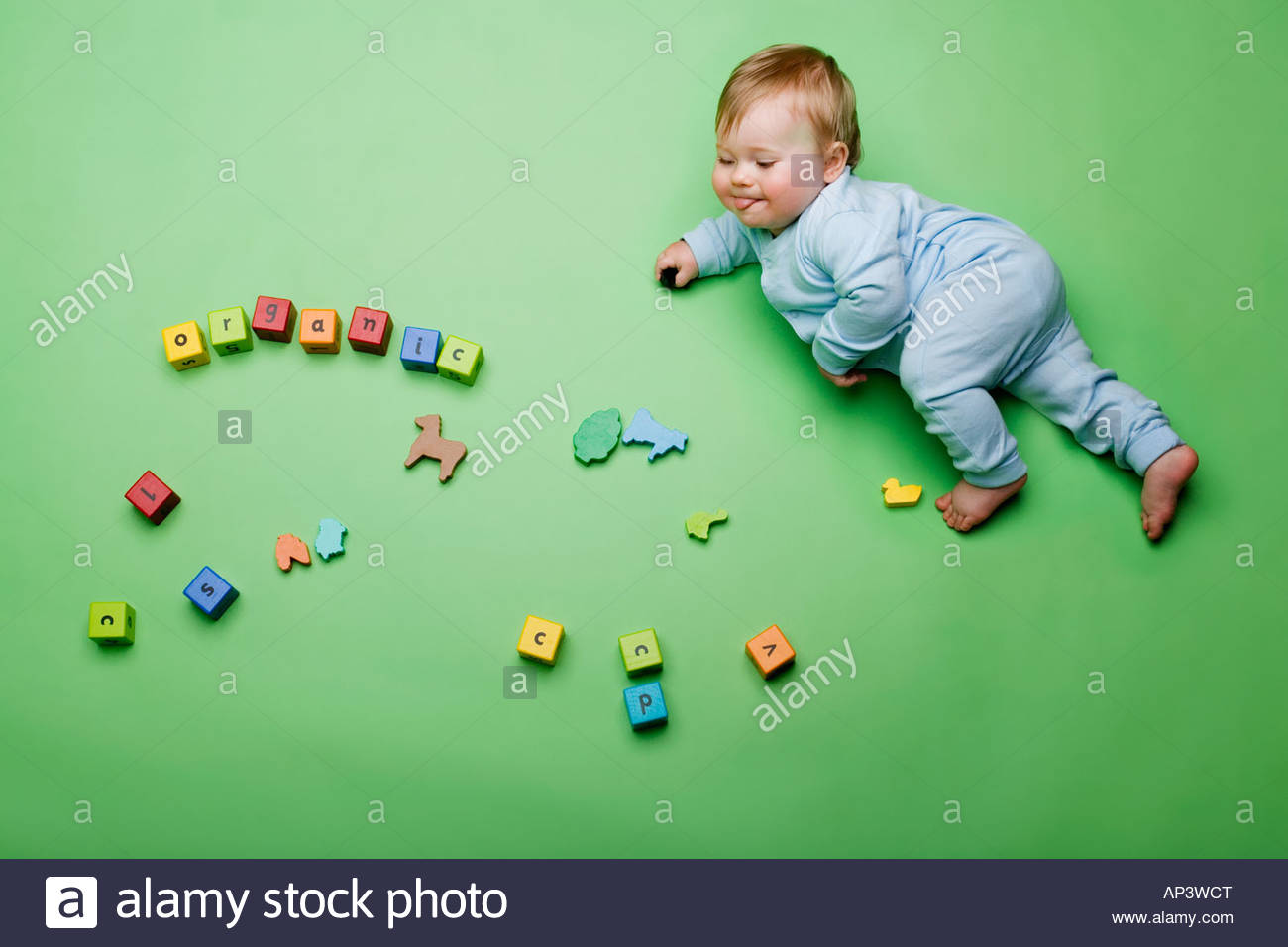 Baby with building blocks spelling organic - Stock Image