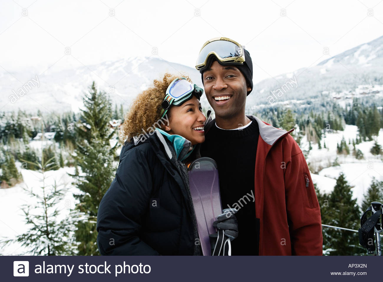 A couple in skiwear - Stock Image