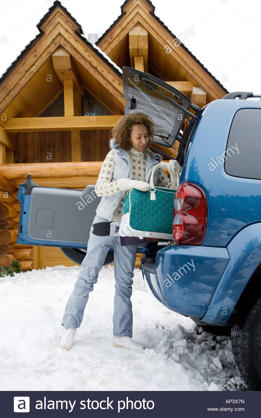 Woman packing car boot - Stock Image