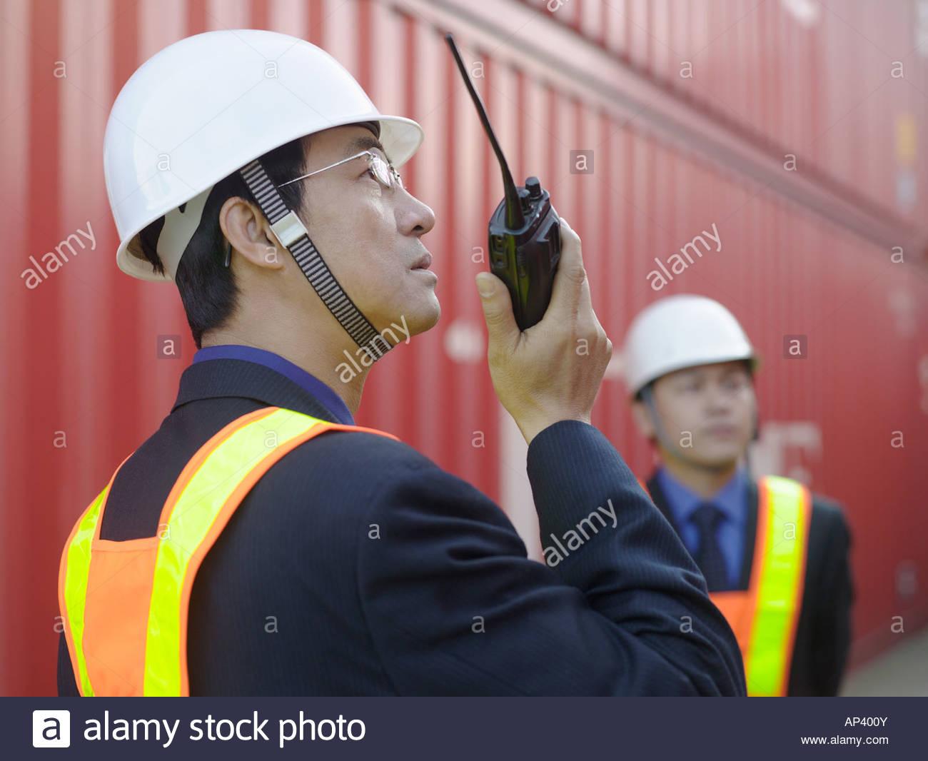 Man using walkie talkie - Stock Image