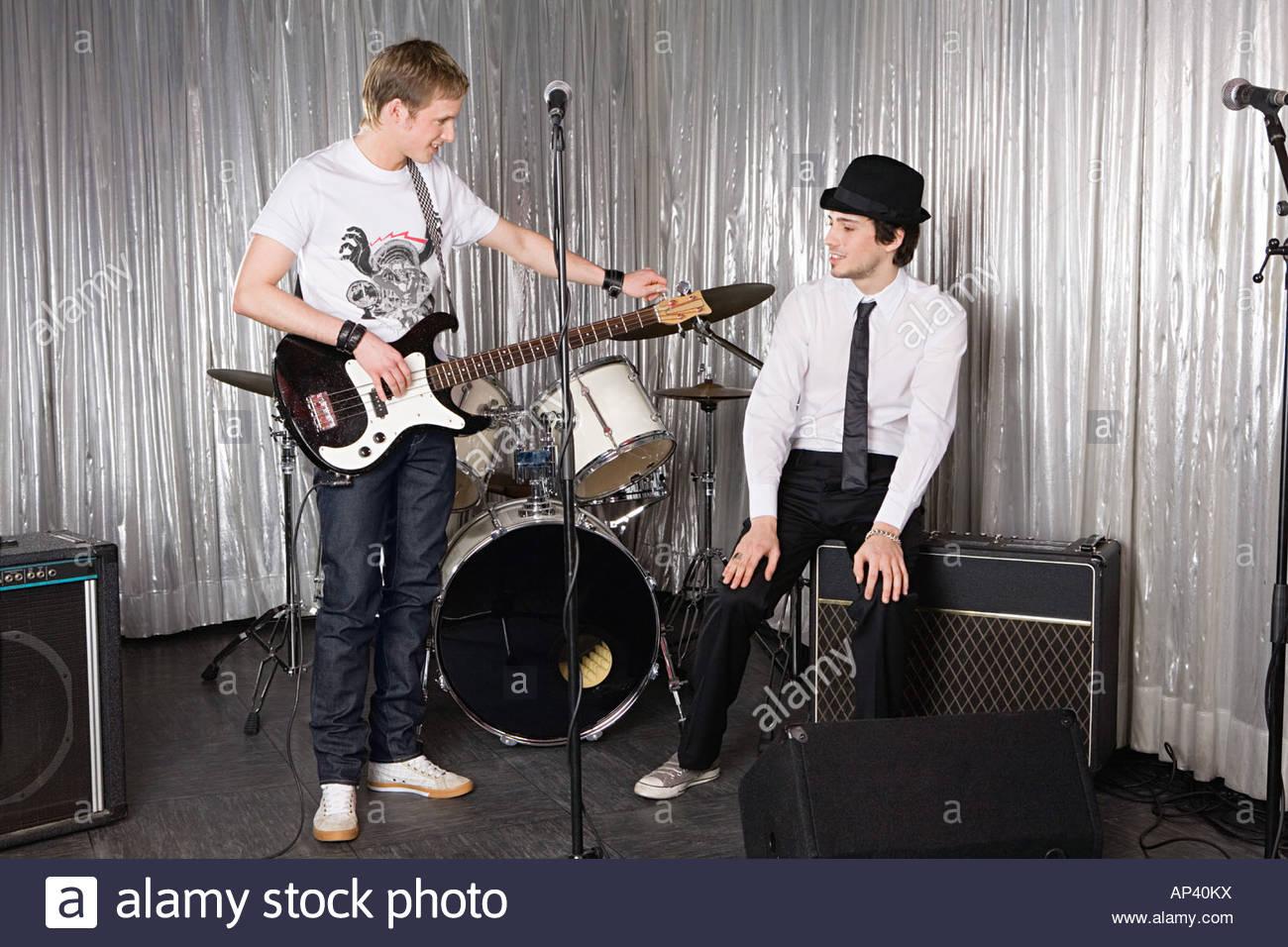 Guitarist tuning guitar - Stock Image