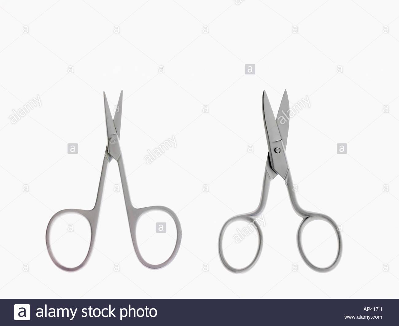 Two pairs of scissors - Stock Image