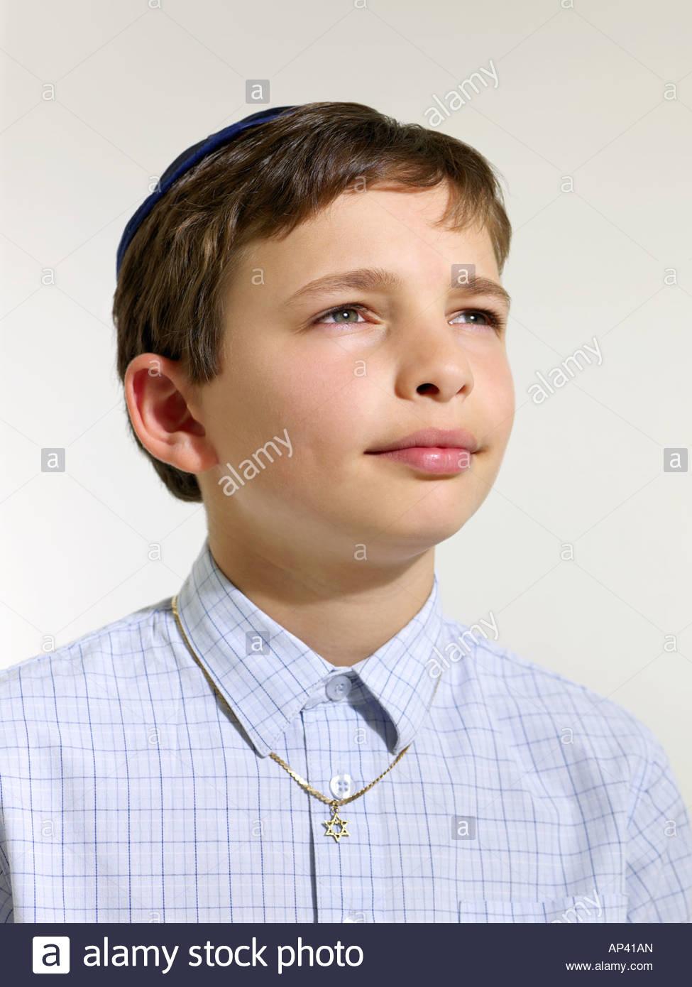 Jewish boy wearing a kippah Stock Photo