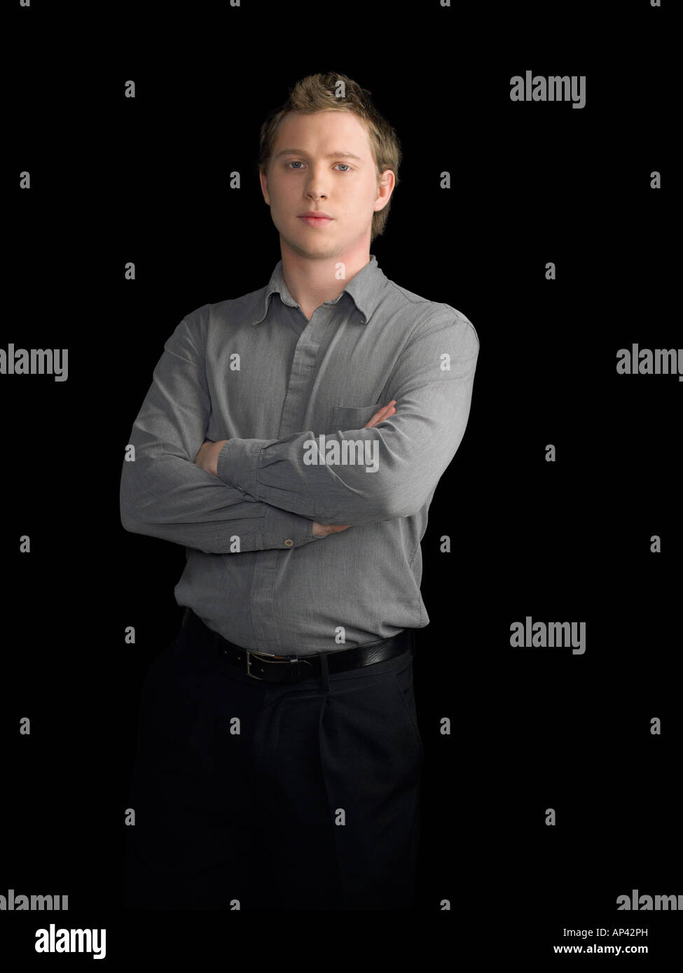 Young man with crossed arms - Stock Image