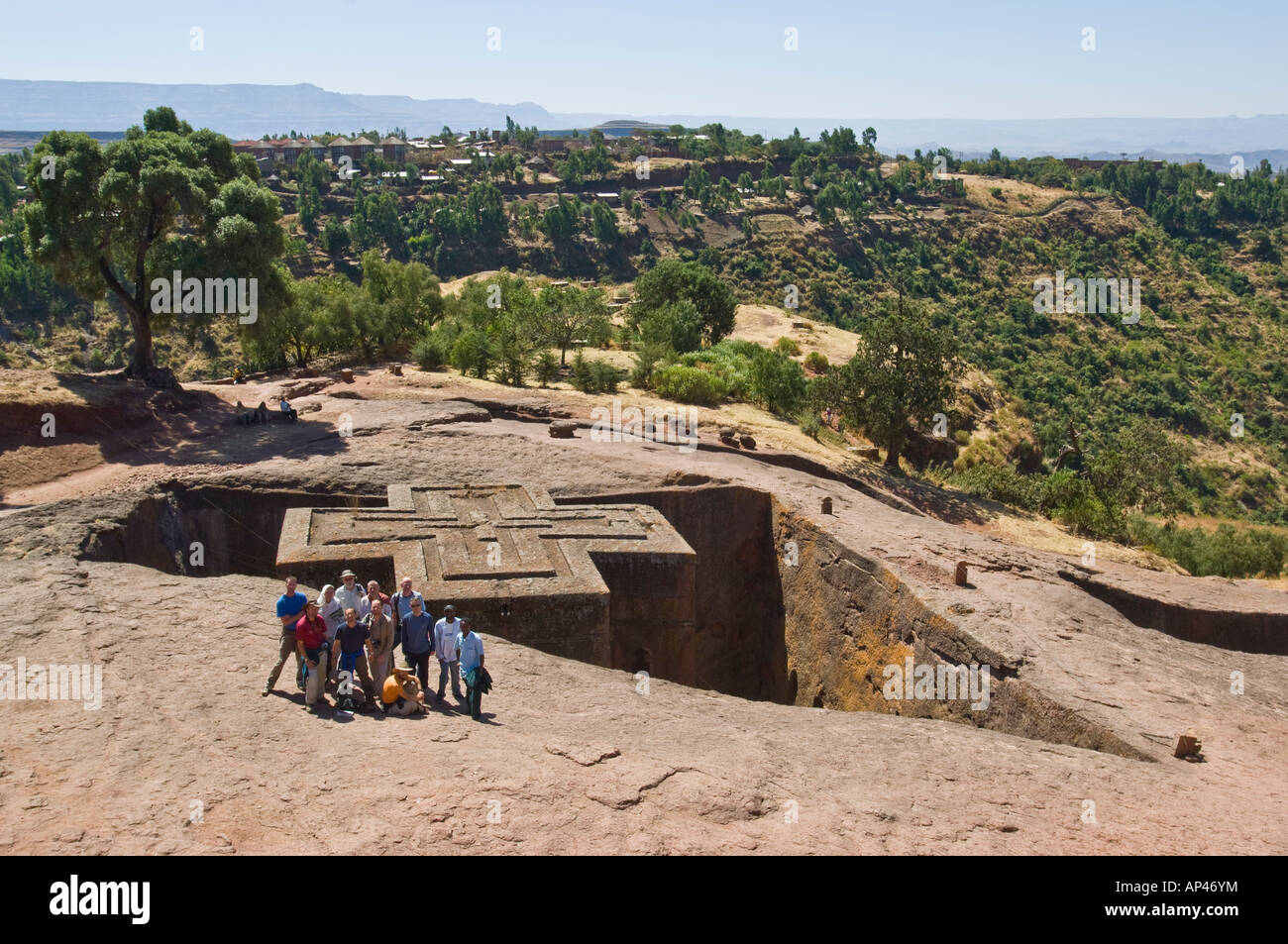 A group of tourists at the Bete Giyorgis or Church of St. George monolithic church in Lalibela. - Stock Image