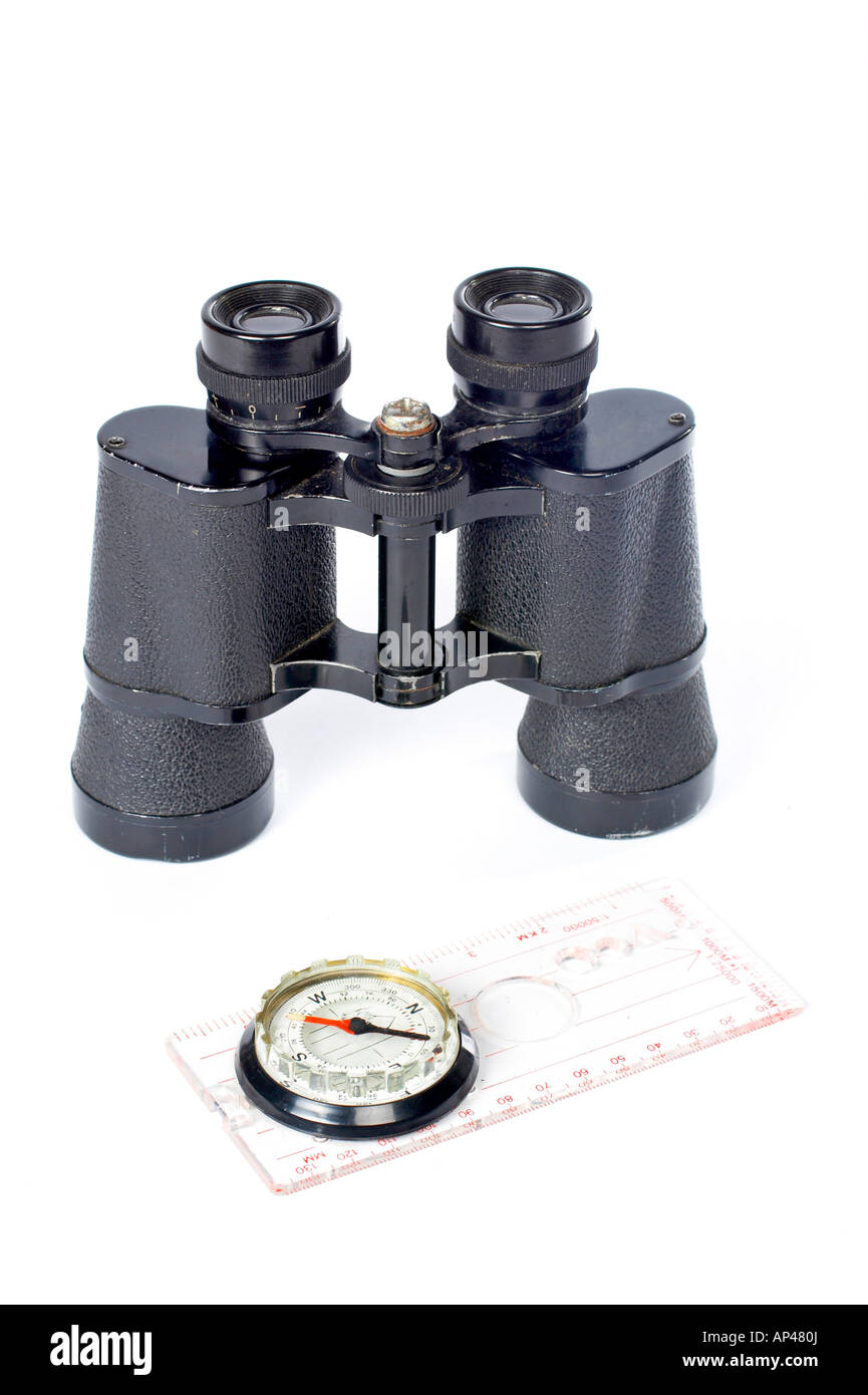 Compass and binoculars on a white background - Stock Image